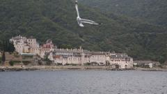 Ship sails along peninsula of Athos, autonomous monastic state in Greece - stock footage