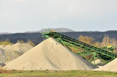 conveyor on site at gravel pit - stock photo