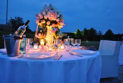 Romantic outdoor dinner Stock Photos