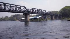 Raft Passing Under the Bridge over the River Kwai in Thailand Stock Footage