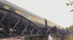 Eastern & Oriental Express Train Travelling Over The Bridge Over The River Kwai Stock Footage