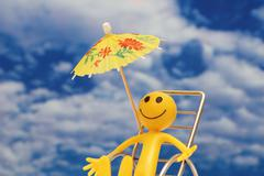 Smilie enjoying sun at the tropical island - stock photo