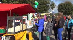 Children row to the cotton candy machine toast saline corn stall Stock Footage