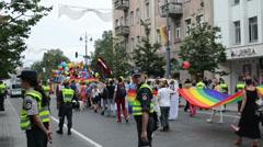 Gay parade members flies high flag. Police ensure discipline Stock Footage