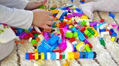 Little girls playing with blocks in kindergarden Stock Footage