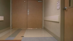 Walk Through Medical Center Doors Stock Footage