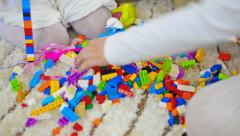 Family child sisters play with toy brick Stock Footage
