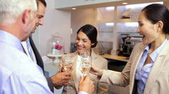 Business team celebrating after work and drinking wine Stock Footage
