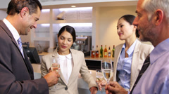 Stock Video Footage of Business associates celebrating after work and drinking wine