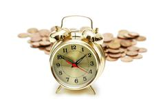 """Time is money"" concept with clock  and coins - stock photo"