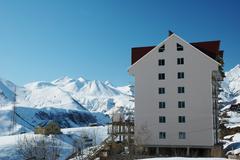 Ski resort hotel in the winter day - stock photo