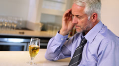 Lonely businessman drinking a beer after work Stock Footage