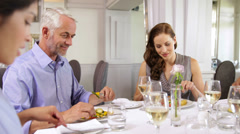 Group of friends having dinner together Stock Footage