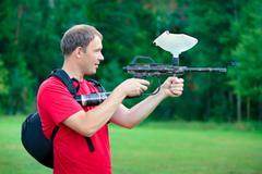 Paintball shooter aiming the gun Stock Photos