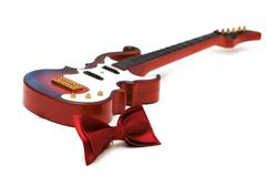 Bow tie and guitar isolated on white - stock photo