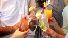 Group of friends toasting with cocktails - stock footage