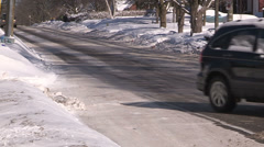 Cars slide on icy road in winter snow storm Stock Footage