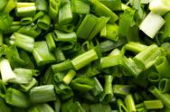Stock Photo of background of chopped green onions. macro