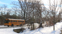 School Bus Drives in Winter Stock Footage