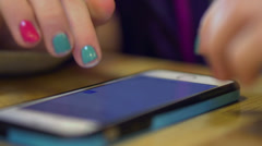 Young girl typing on smart phone - stock footage