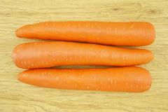 fresh carrot wood background - stock photo