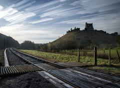 unique time lapse stack landscape of medieval castle and railway tracks - stock photo