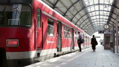 Passsengers on the railroad station platform - stock footage