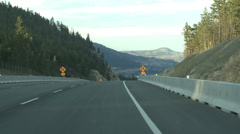 Drive plate, POV drive on hwy 97 medium opens onto two lakes Stock Footage