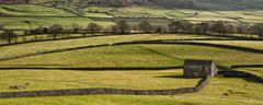 Panorama landscape traditional stone barn in autumnal countryside lit with sun Stock Photos