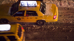 Taxis at Night in the Snow Stock Footage