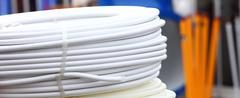rolled up of white hose pipe - stock photo