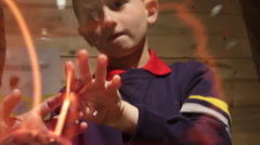 Boy Amazed with the tricks of the FireBall - stock footage