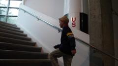 "American boy climbing staircase near a ""rocket"" Stock Footage"