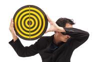 Businessman holding target Stock Photos