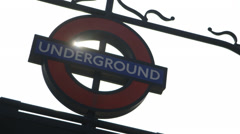 Sun shines through London Underground Sign Stock Footage