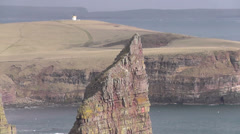 Stacks of Duncansby and Duncansby head lighthouse Scotland Stock Footage