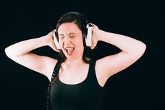 Pretty Woman With Retro Headphones Screaming - stock photo