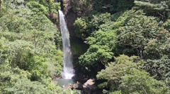 water cascading over waterfall in tropical climate - stock footage