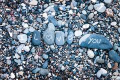 I love you note on rocks Stock Photos