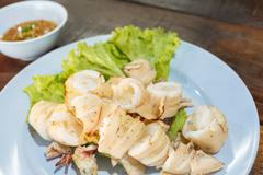 Stock Photo of grilled squid on dish.
