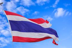 defective waving flag of thailand and blue sky background - stock photo