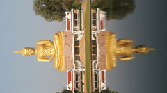 Reflection of gold buddha Stock Footage