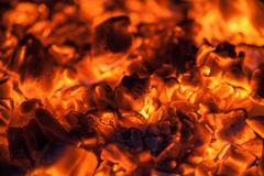 bright orange embers in a wood stove - stock photo