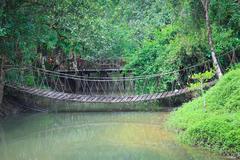 Rope bridge  across river Stock Photos