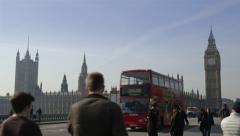 Houses of Parliament. London Traffic crosses Westminster Bridge Stock Footage