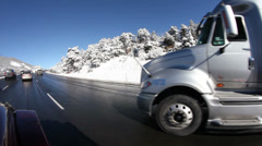 Driving up a mountain highway in heavy traffic after snow Stock Footage