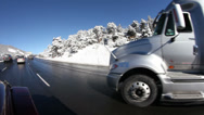 Stock Video Footage of Driving up a mountain highway in heavy traffic after snow