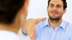 Businessman shaking hands with job applicant Stock Footage