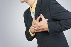 Businessman having heart attack Stock Photos