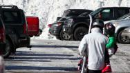 Stock Video Footage of Father carrying child to truck at ski resort